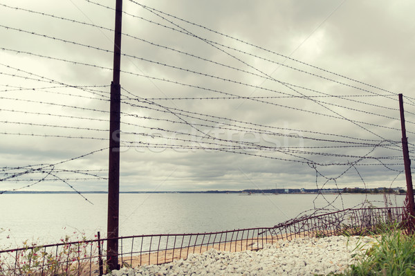 Foto d'archivio: Filo · recinzione · grigio · cielo · mare · acqua