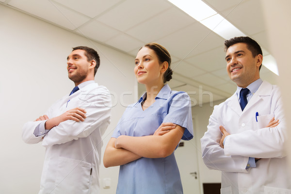 Stock photo: group of happy medics or doctors at hospital
