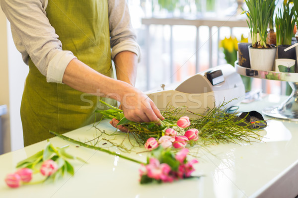 close up of man making bunch at flower shop Stock photo © dolgachov