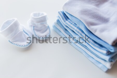 close up of soother and baby clothes for newborn Stock photo © dolgachov