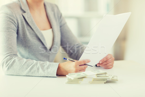close up of female hands with money and tax report Stock photo © dolgachov