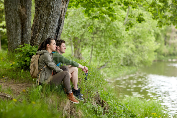 smiling couple with backpacks in nature Stock photo © dolgachov