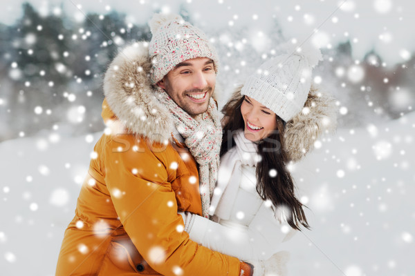happy couple hugging and laughing in winter Stock photo © dolgachov