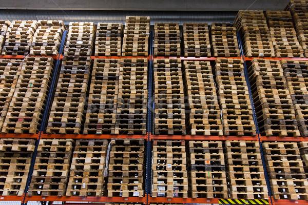 wooden cargo pallets storing at warehouse shelves Stock photo © dolgachov