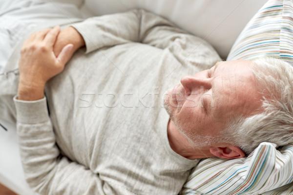 close up of senior man sleeping on sofa Stock photo © dolgachov