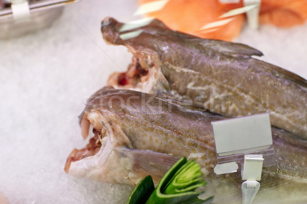 Stock photo: fresh fish on ice at grocery stall