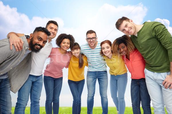 international group of happy people hugging Stock photo © dolgachov