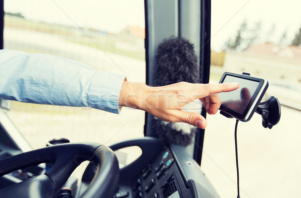 close up of bus driver driving with gps navigator Stock photo © dolgachov