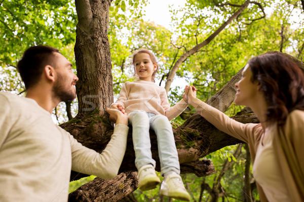 happy family in summer park having fun Stock photo © dolgachov