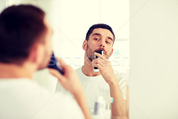 Homem bigode banheiro beleza higiene Foto stock © dolgachov
