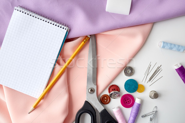 scissors, sewing tools, cloth and notepad Stock photo © dolgachov