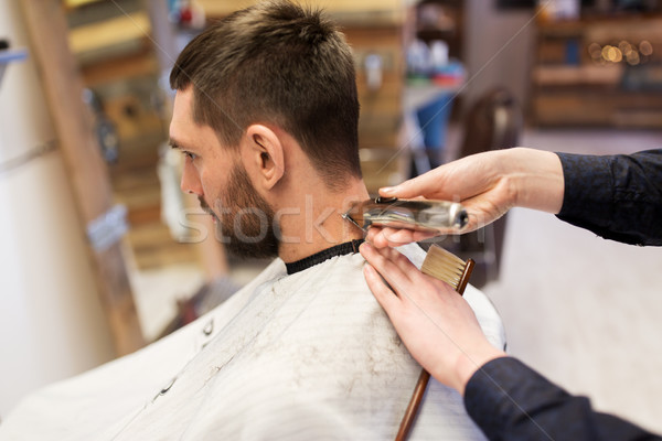 Homme barbier mains cheveux Photo stock © dolgachov