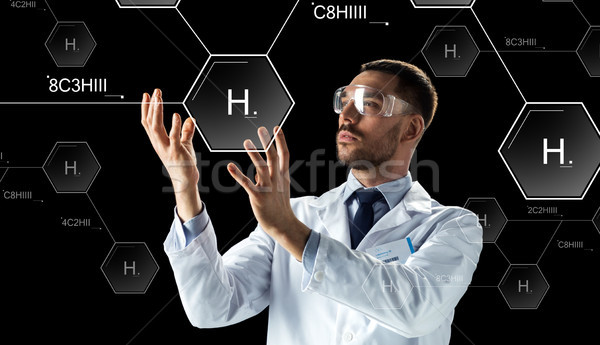 scientist in lab goggles chemical formula Stock photo © dolgachov