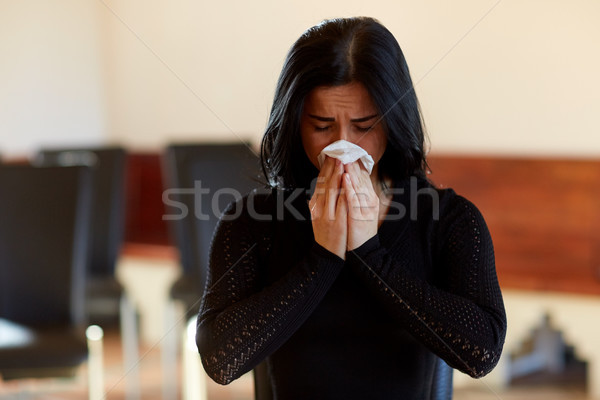 crying woman with wipe at funeral in church Stock photo © dolgachov