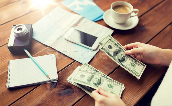 Stock photo: close up of traveler hands counting dollar money