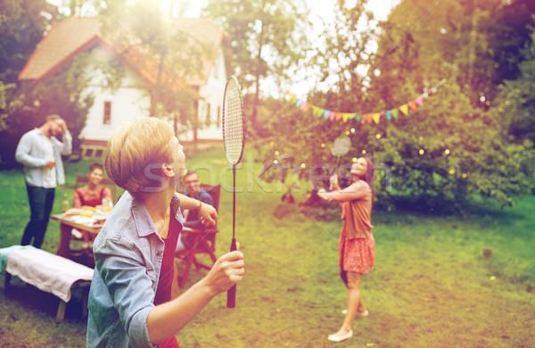 Feliz amigos jogar badminton verão jardim Foto stock © dolgachov