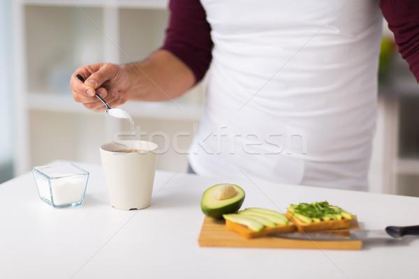 человека завтрак сахар кофе еды люди Сток-фото © dolgachov