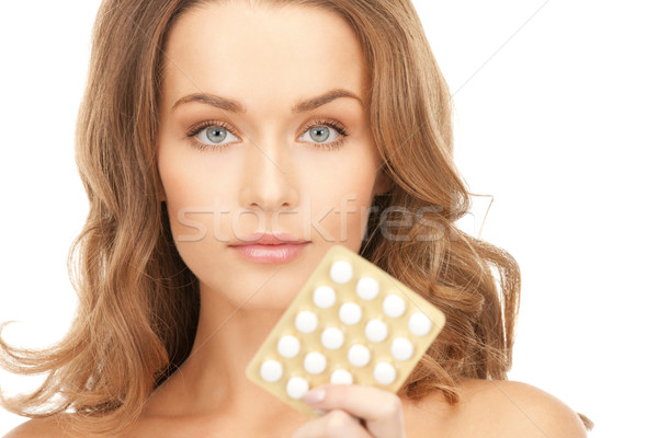 Stock photo: young beautiful woman with pills