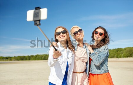 smiling young hippie friends near minivan car Stock photo © dolgachov