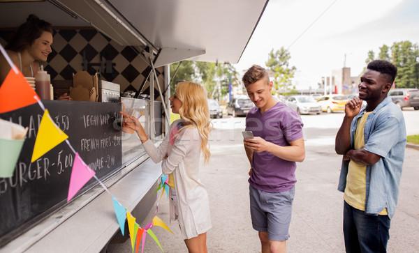Felice clienti coda alimentare camion strada Foto d'archivio © dolgachov