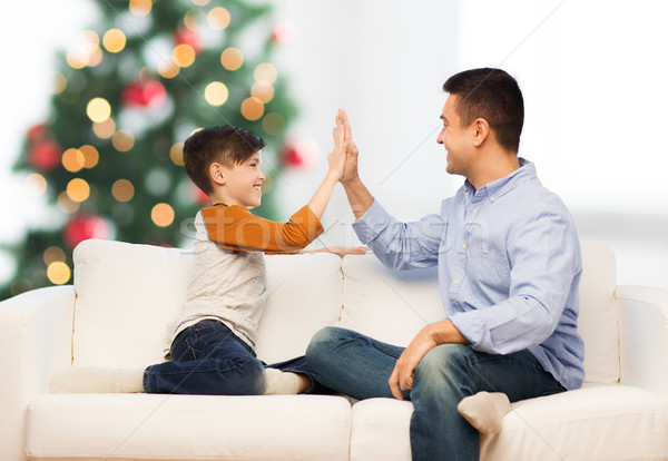 happy father and son doing high five at christmas Stock photo © dolgachov