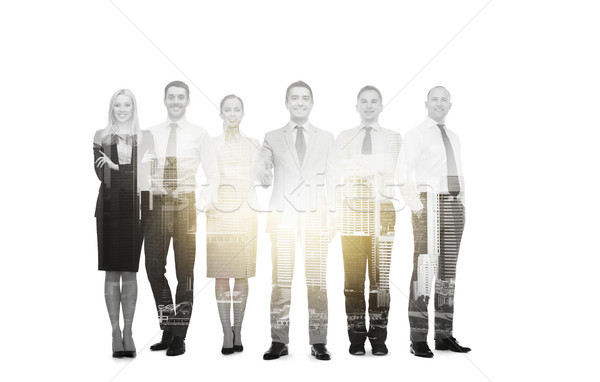 Stock photo: group of smiling businessmen making handshake
