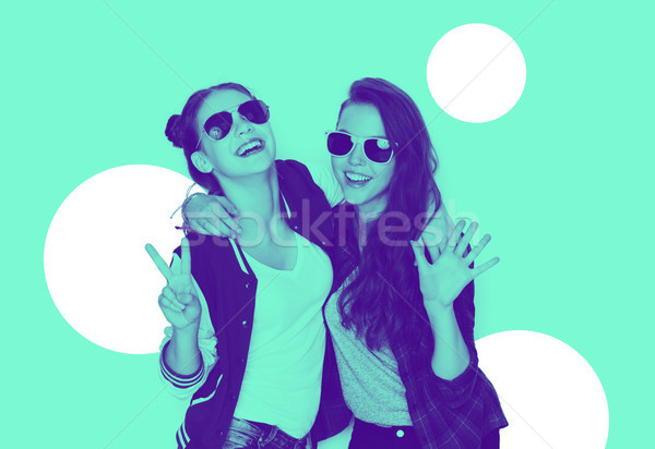 Stock photo: smiling teenage girls in sunglasses having fun