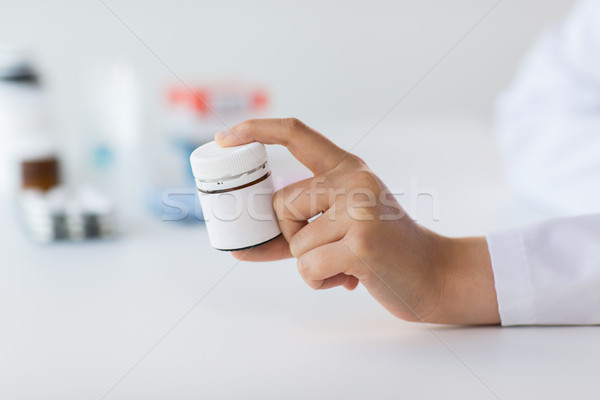 close up of doctor hand with medicines Stock photo © dolgachov