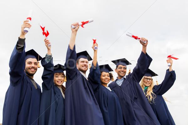 Boldog diákok oktatás érettségi emberek csoport Stock fotó © dolgachov