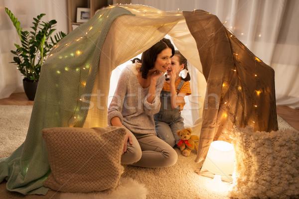 Boldog család suttog gyerekek sátor otthon család Stock fotó © dolgachov