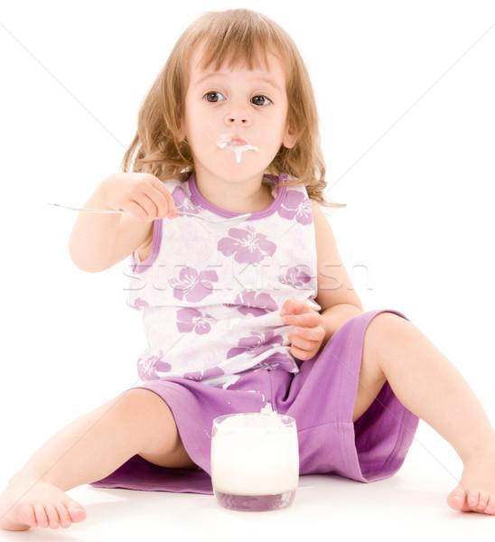 Kislány joghurt kép eszik fehér étel Stock fotó © dolgachov