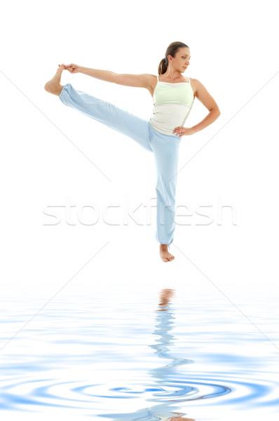 yoga standing on white sand #2 Stock photo © dolgachov
