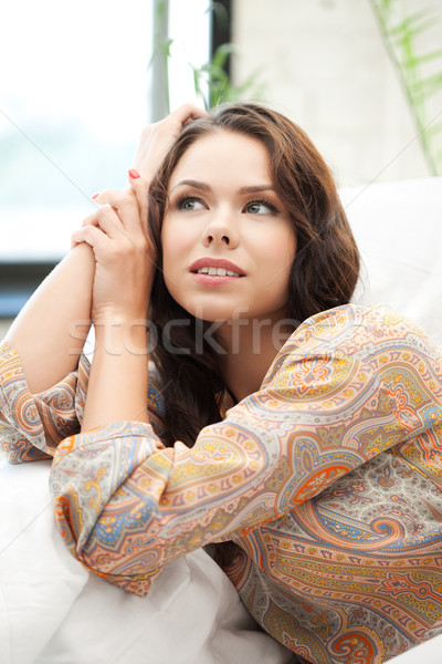 daydreaming woman Stock photo © dolgachov