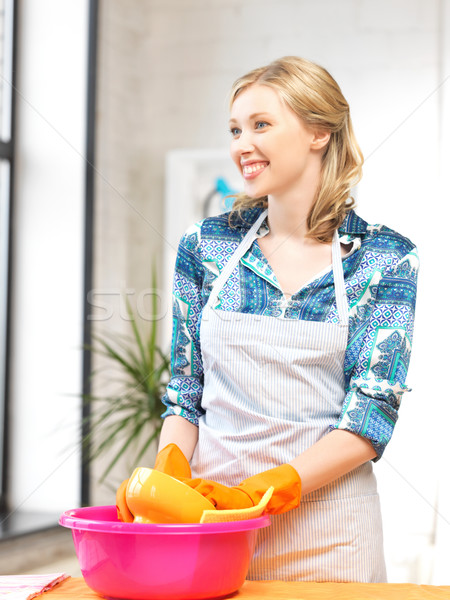 housewife washing dish at the kitchen Stock photo © dolgachov