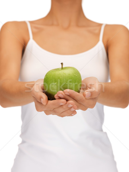 female hands with green apple Stock photo © dolgachov