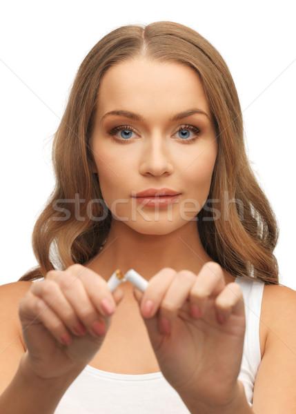woman with broken cigarette Stock photo © dolgachov