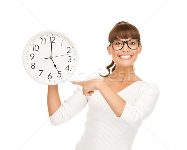Сток-фото: деловая · женщина · указывая · пальца · стены · часы · привлекательный