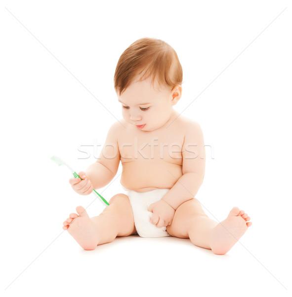 Kíváncsi baba fogmosás fényes kép család Stock fotó © dolgachov