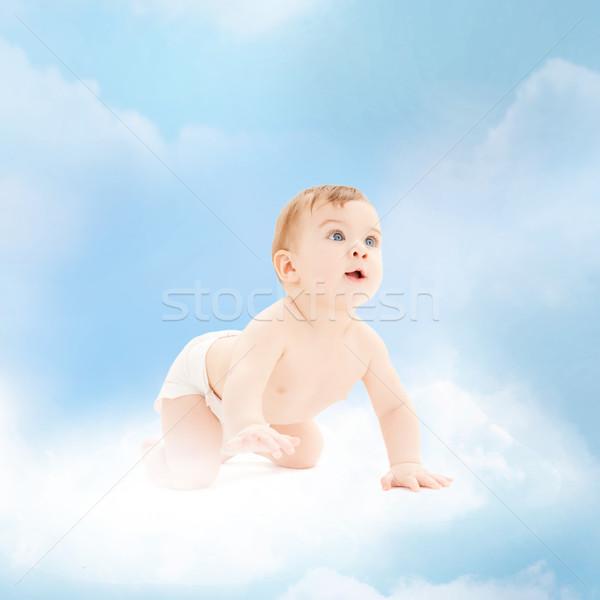 Mosolyog baba ül felhő gyermekkor gyermekgondozás Stock fotó © dolgachov