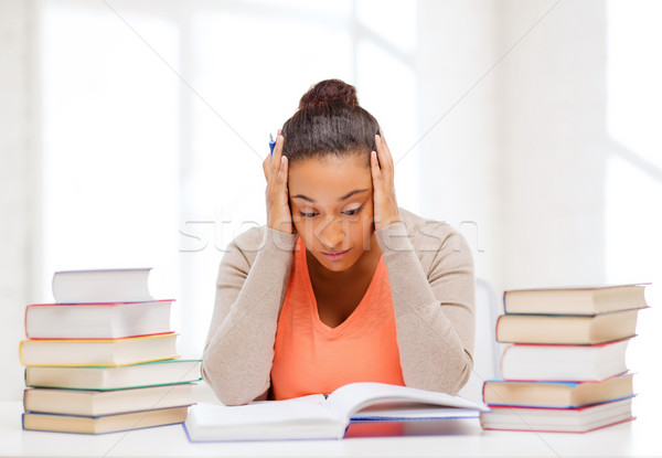 tired student with books and notes Stock photo © dolgachov