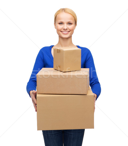 smiling woman in casual clothes with parcel boxes Stock photo © dolgachov