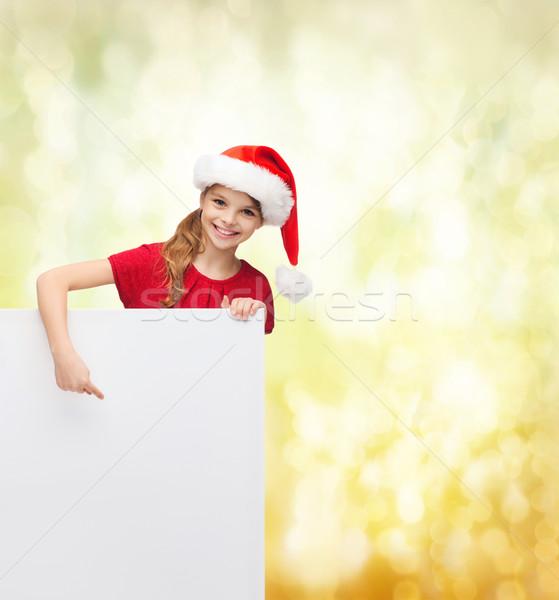Gyermek mikulás segítő kalap fehér tábla karácsony Stock fotó © dolgachov