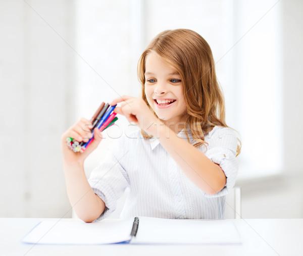 Stock photo: smiling girl choosing colorful felt-tip pen