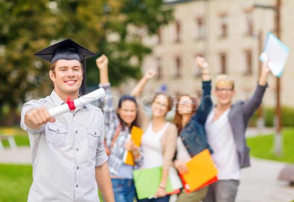 Mosolyog tizenéves fiú diploma oktatás kampusz tini Stock fotó © dolgachov