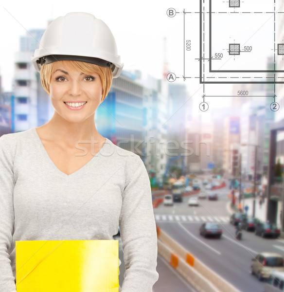 female contractor in helmet with folder Stock photo © dolgachov