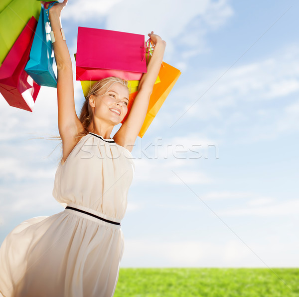 woman with shopping bags Stock photo © dolgachov