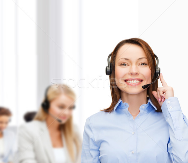 friendly female helpline operator at office Stock photo © dolgachov