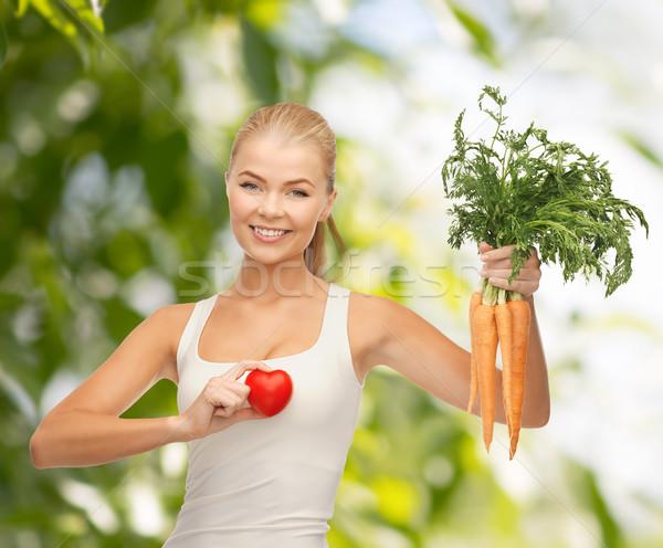 улыбающаяся женщина сердце символ морковь здоровья Сток-фото © dolgachov