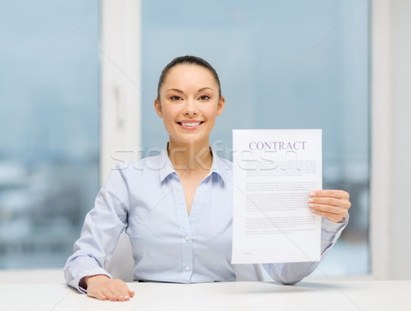 happy businesswoman holding contract in office Stock photo © dolgachov
