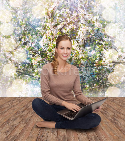 young woman sitting on floor with laptop Stock photo © dolgachov